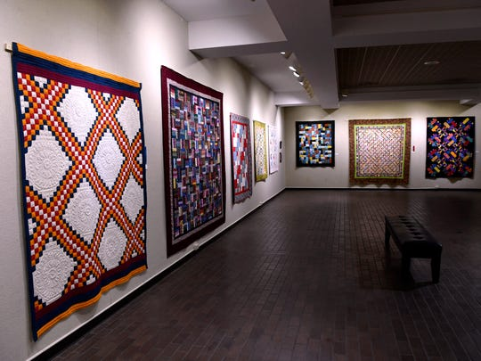 Several quilts hang in the main gallery of the Breckenridge Fine Arts Center.
