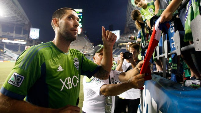 Seattle Sounders FC forward Clint Dempsey (2) gives a thumbs-up while signing autographs following a 2-0 victory against the Portland Timbers at CenturyLink Field.
