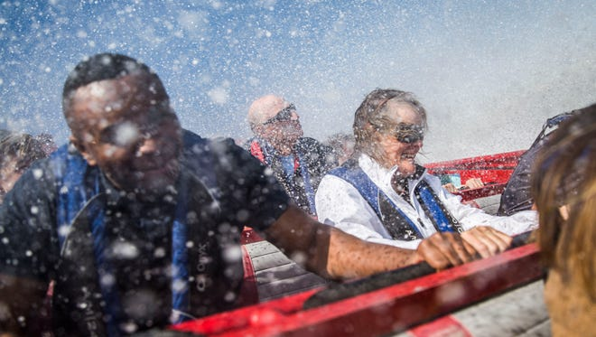 Claire Moses, center, laughs as water sprays over her seat on a Jet Boat Naples ride in Naples, Fla. on Thursday, March 15, 2018.
