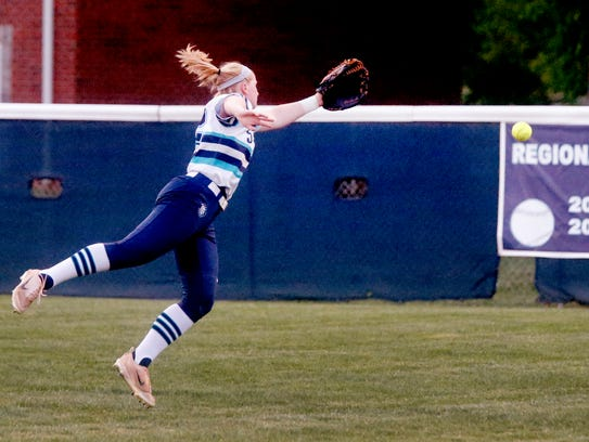 Siegel's Madison Levi (22) jumps for a ball hit in