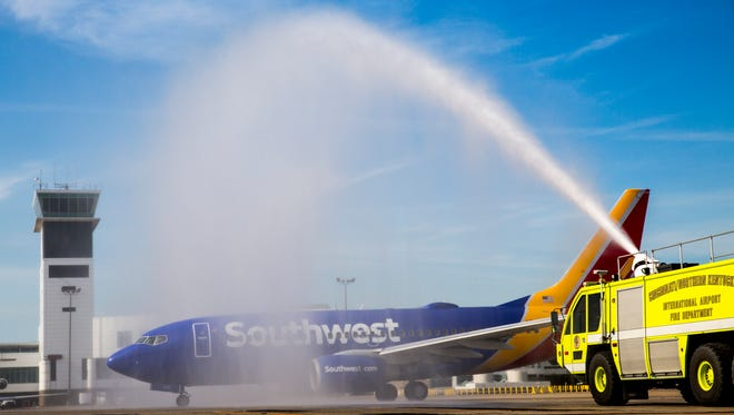 The CVG fire department sprays a ceremonial water arch over the first Southwest plane to take off from Cincinnati/Northern Kentucky International Airport on Sunday morning, June 4, 2017.