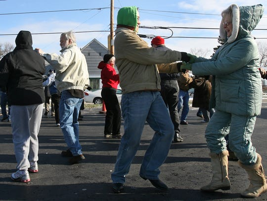 Members of the Grand Spinners dance in the cold on