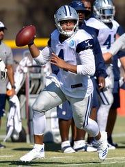 Quarterback Dak Prescott looks for someone to throw