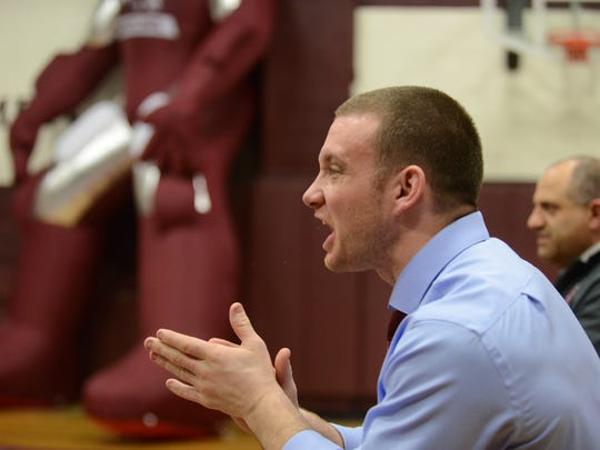Don Bosco Prep Head Wrestling Coach Austin Wall applauds moves by one of his wrestler as rivals No.1 ranked Bergen Catholic visits No. 2 ranked Don Bosco Prep, Wednesday, Jan 25.