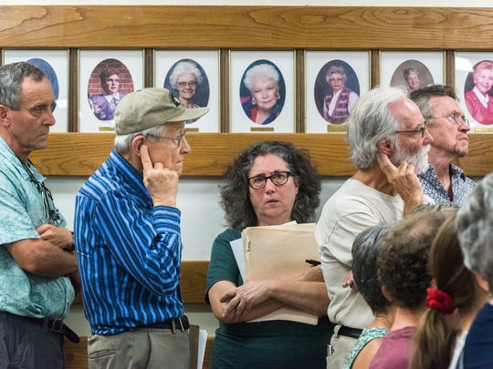 Attendees of a town hall meeting held by congressman Patrick McHenry wait in line to offer questions Tuesday, August 22, 2017.