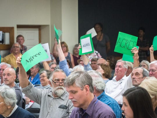 Attendees of a town hall meeting at the Land of Sky