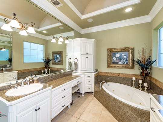 The master suite includes an en suite bathroom with
