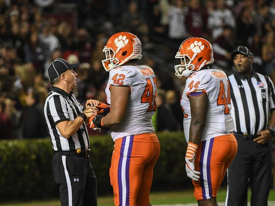 A referee asks for a water bottle Clemson defensive