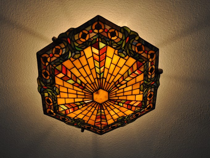 Stained-glass lighting in the entryway.