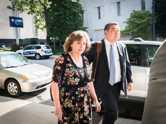 Wanda Greene, former Buncombe County Manager, walks to the federal courthouse with her attorneys Noell Tin and Thomas Amburgey Wednesday, June 13, 2018, to appear before a U.S magistrate judge where she will be indicted on additional charges of using public money to buy life insurance policies for herself and other employees. Greene was indicted in April on charges of wire fraud, conspiracy, embezzlement and aiding and abetting.