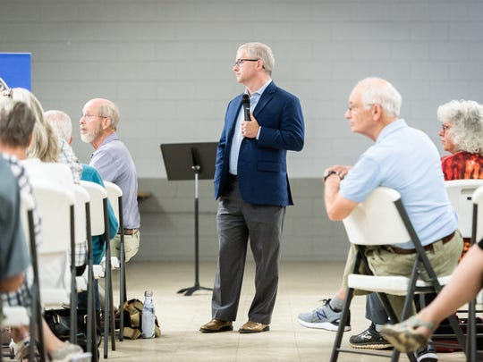 Patrick McHenry, the U.S representative for North Carolina's 10th congressional district, listens to a question during the town hall meeting at the Riceville Volunteer Fire Department Wednesday.