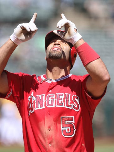 Albert Pujols celebrates after hitting a two-run home