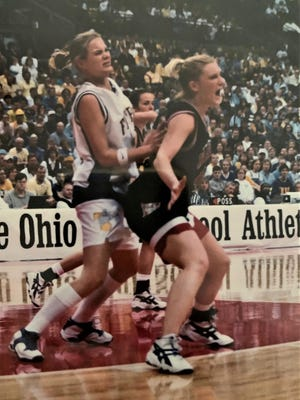 Jill Yoder battles on the low post during state tournament action in March 2000, when Hiland claimed its first of five state championships.