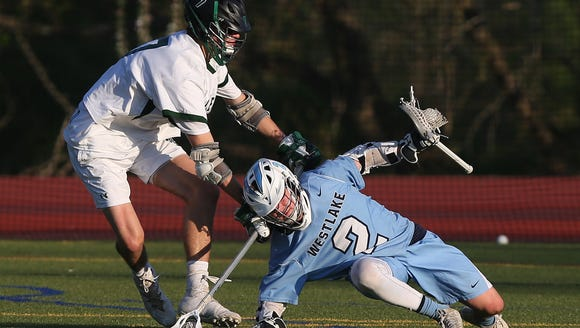 From left, Pleasantville's Cullen Dell (7) puts pressure