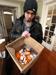 Andrew Greenspan with a box of medications he has stopped