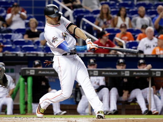 Miami Marlins' Giancarlo Stanton hits a two-run home run during the first inning of a baseball game against the San Francisco Giants, Monday, Aug. 14, 2017, in Miami. (AP Photo/Lynne Sladky)