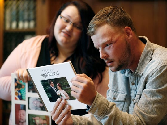 Lilly Ross, left, shows her family photos to Andy Sandness