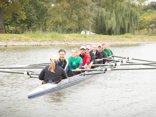 With a coxswain providing commands, a group of eight