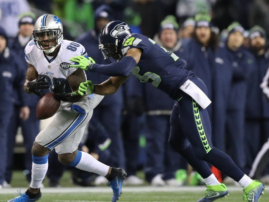 DeShawn Shead defends Anquan Boldin in a 2017 playoff game in Seattle.