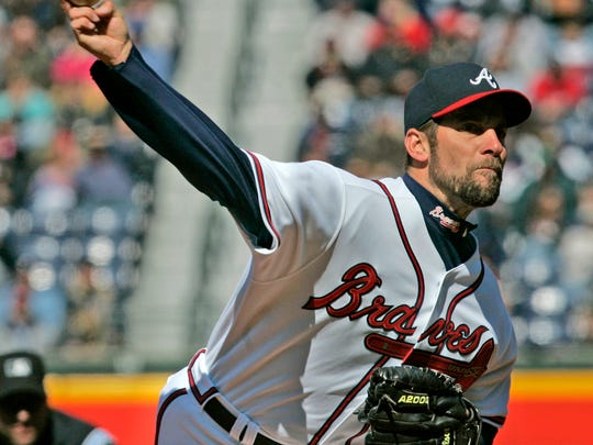 FILE- In this April 7, 2007, file photo, Atlanta Braves starter John Smoltz works against the New York Mets in the first inning of a baseball game in Atlanta. Smoltz was elected to the National Baseball Hall of Fame Tuesday, Jan. 6, 2015. (AP Photo/John Bazemore, File)