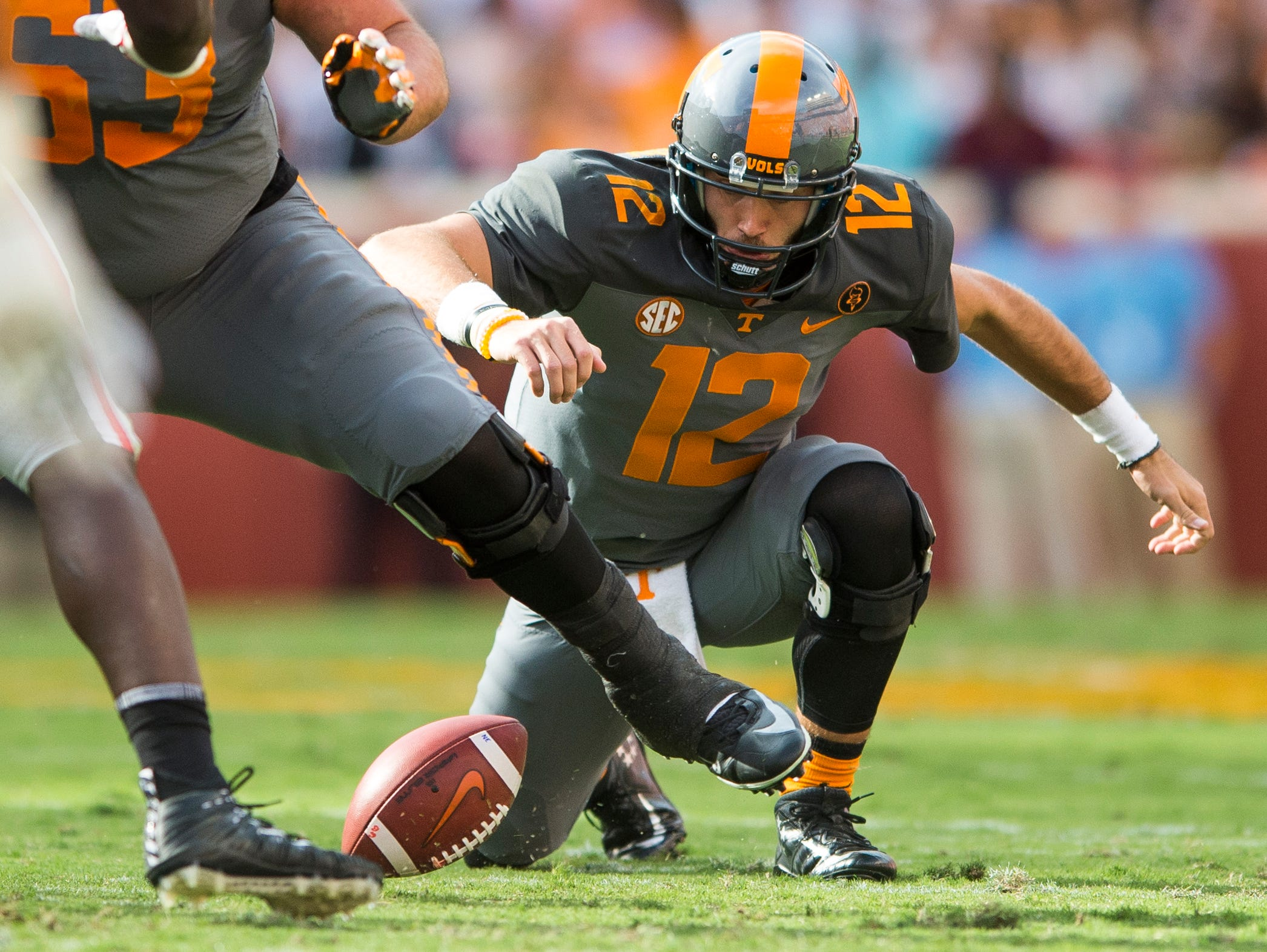 Tennessee quarterback Quinten Dormady (12) fumbles the snap, which would then be recovered by Georgia, during Tennessee's game against Georgia in Neyland Stadium on Saturday, Sept. 30, 2017.