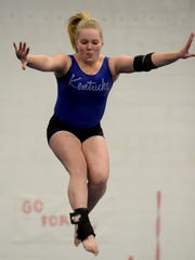Centerville's Sarah Rohe practices her beam routine