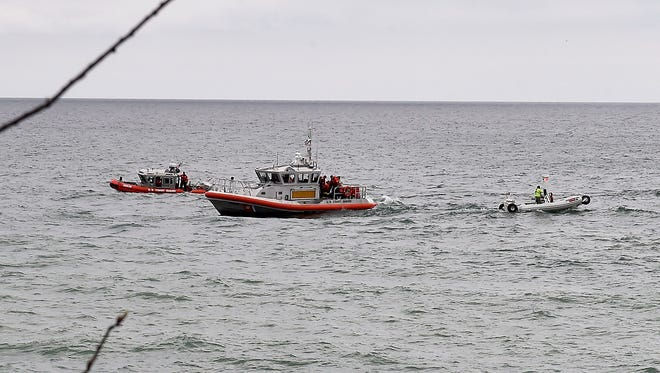 Rescue boats involved in the search and recovery of two kayakers in Lake Michigan off Cave Point County Park on April 28. Both kayakers later died.