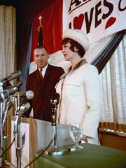 James Lovell looks on as his wife, Marilyn, speaks at a news conference.