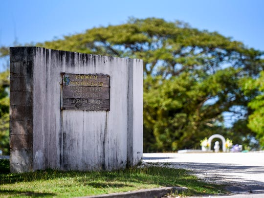 A sign greets visitors at the entrance to the Vicente A. Limtiaco Memorial Cemetery in Piti on Thursday, Jan. 4, 2018.