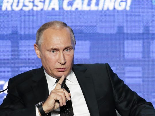 Russian President Vladimir Putin gestures while speaking at in Moscow.