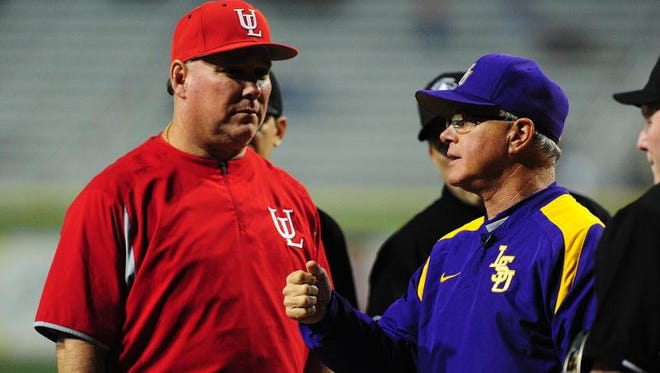 UL head coach Tony Robichaux and LSU head coach Paul Mainieri speak prior to their game earlier this season. The two teams are currently heading in different directions.