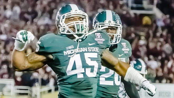 Darien harris (45) of MSU celebrates after being part of the trio of Spartans that stopped Ryan Hewitt of Stanford on 4th and 1 with 1:45 remaining in the fourth quarter of the 2014 Rose Bowl Jan. 1, 2014 in Pasadena, Calif.