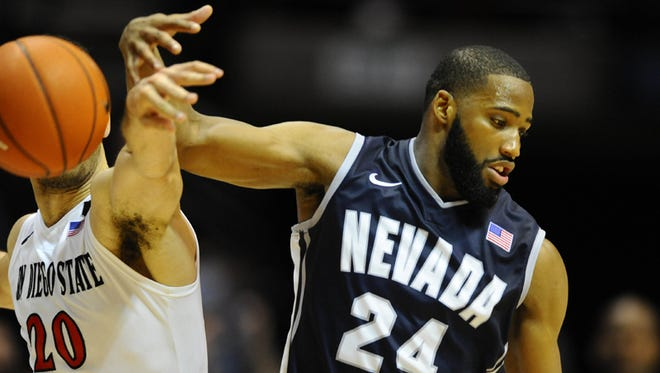 Feb 8, 2014; San Diego, CA, USA; Nevada Wolf Pack guard Deonte Burton (24) has the ball knocked away by San Diego State Aztecs forward JJ O'Brien (20) during the second half at Viejas Arena.