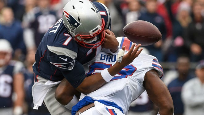 Jacoby Brissett (7) of the New England Patriots fumbles while being tackled by Zach Brown (53) of the Buffalo Bills in the second quarter at Gillette Stadium on Oct. 2, 2016, in Foxborough, Massachusetts.