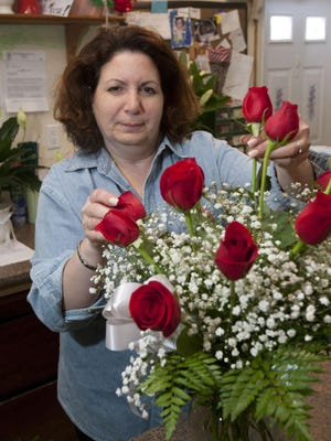Ana Rinaudo, owner of Ana's Flowers and Gifts, in Middletown.
