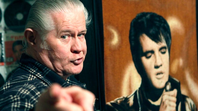In this Dec. 9, 2009, photo, Elvis Presley fanatic Paul MacLeod leads a tour of the antebellum home he called Graceland Too, in Holly Springs.