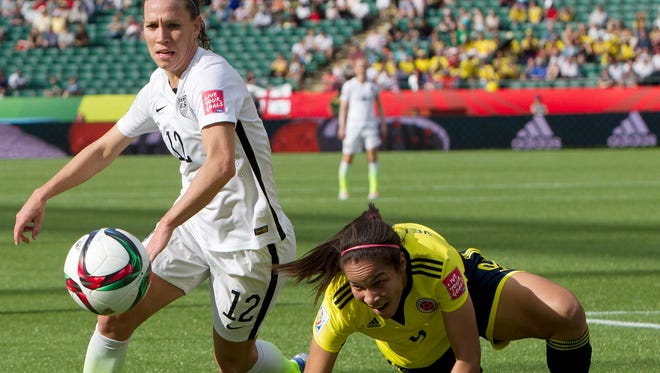 United States' Lauren Holiday (12) and Colombia's Orianica Velasquez (9) watch the ball during first half FIFA Women's World Cup round of 16 soccer action Monday in Edmonton, Alberta, Canada.