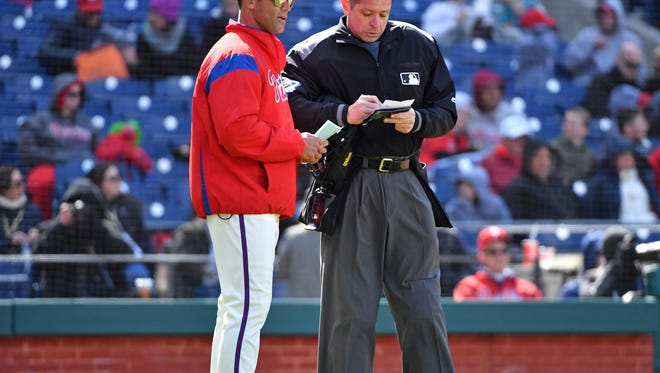 Philadelphia Phillies manager Gabe Kapler (22) talks to umpire Carlos Torres (37) during the seventh inning against the Miami Marlins at Citizens Bank Park. Mandatory Credit: Eric Hartline-USA TODAY Sports
