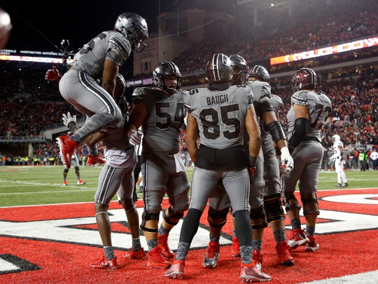 Ohio State tight end Marcus Baugh celebrates his game-winning touchdown catch with teammates.