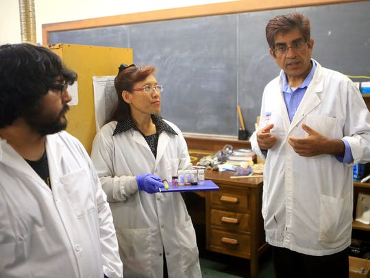 Professor Sajid Bashir (right) talks about advance fingerprint detection technology with Professor Louise Liu (center) and Pete Villarreal on July 12, 2017, at Texas A&M University-Kingsville in Kingsville.