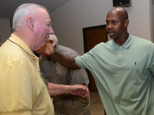 Retired major league outfielder Juan Pierre (right) reaches out to hug Jodie White who was Pierre's summer league baseball coach. A retirement celebration was held for Pierre at St. Juliana Catholic Church in 2015. Those who grew up with him and watched him grow up and develop into an athlete were on hand to wish him well.