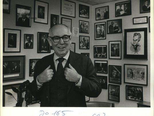 1983 Press Photo Firm Chairman Robert Zigman's of office walls evokes memories