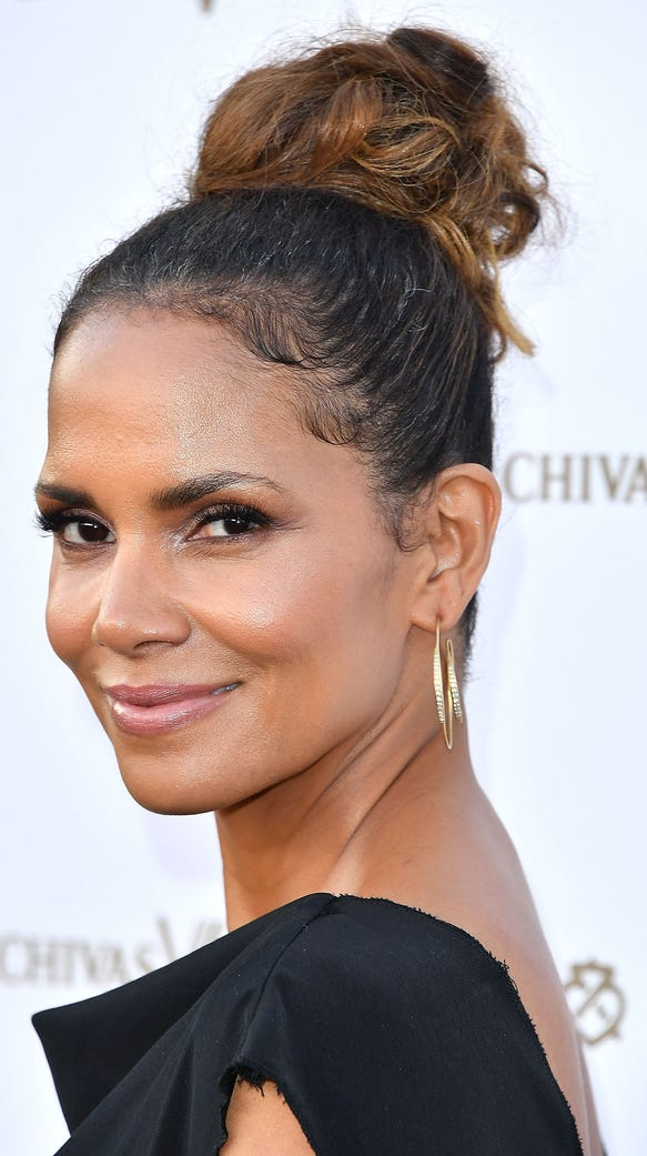Halle Berry wore gold jewelry with the outfit.