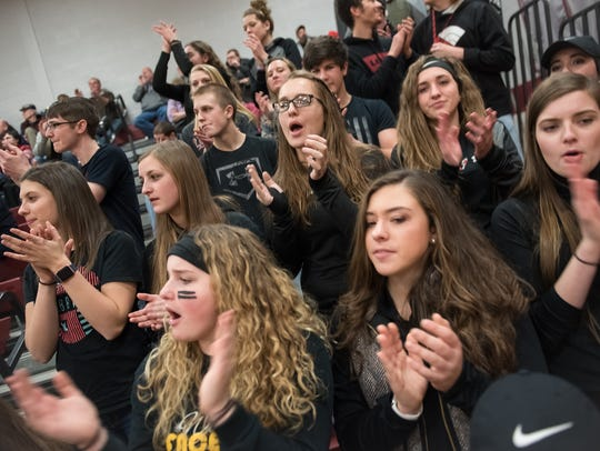 Greencastle students clap and cheer on their team during