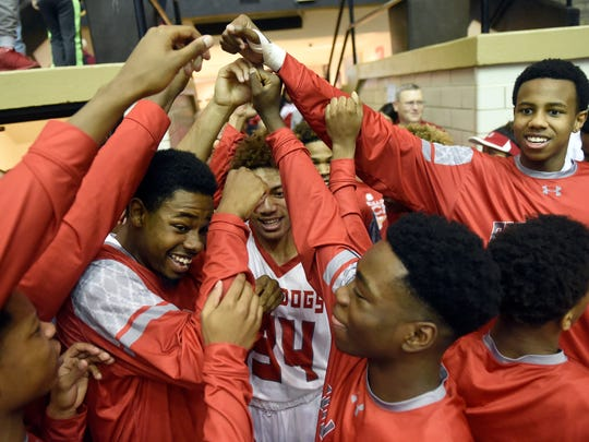 Bosse players huddle together before going up against Brownstown Central at the Hatchet House in Washington Saturday.  Bosse defeated Brownstown Central 81-71 in overtime to advance in the Class 3A Regional championship game.