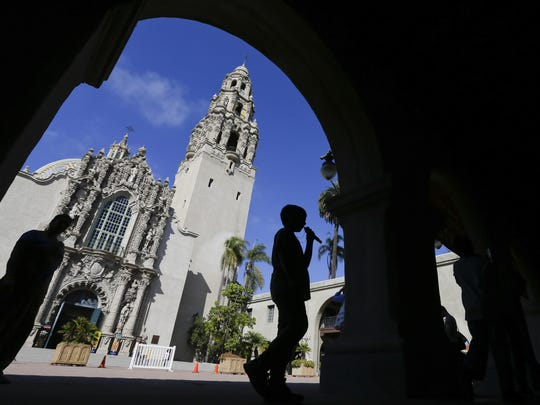 A boy walks past a building in Balboa Park in San Diego. Balboa Park will be marking its 100th anniversary in 2015 with a host of festivities,. The 1,200-acre urban oasis that rivals New York's Central Park is home to the San Diego Zoo.