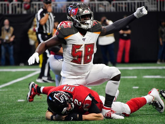 Tampa Bay Buccaneers linebacker Shaquil Barrett (58) celebrates his sack on Atlanta Falcons quarterback Matt Ryan during the first half of an NFL football game, Sunday, Nov. 24, 2019, in Atlanta. (AP Photo/John Amis)
