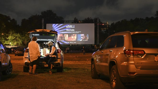 "Filmgoers attend the ""Nomadland"" screening at the Queens Drive-In at the New York Hall of Science during the 58th New York Film Festival in New York on Sept. 26, 2020."