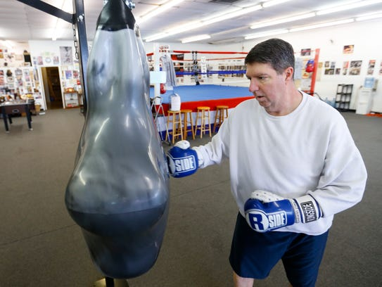 Paul Kahmann punches a bag at Smitty's Mid-West Boxing