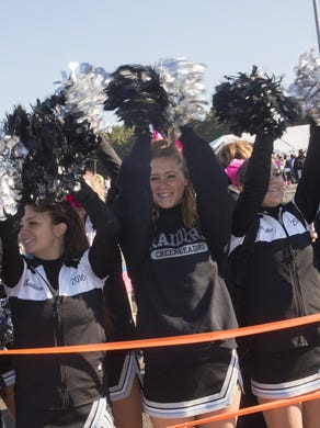 2014: Toms River East Cheerleaders shout out for the Survivors Walk at the 21st Annual Susan G Komen Race For the Cure at Six Flags Great Adventure on October 5, 2014.
